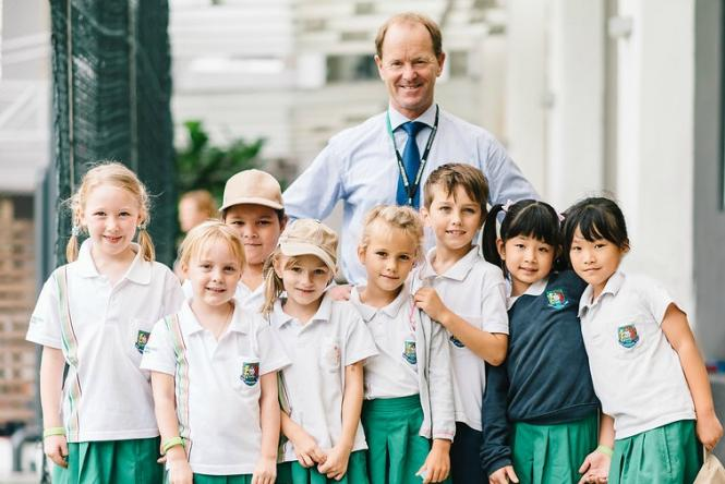 *Photo: School principal, Mark Ford and students from Garden International School