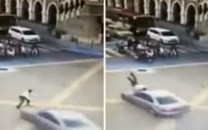 Policeman in Kuala Lumpur rammed by car while directing traffic